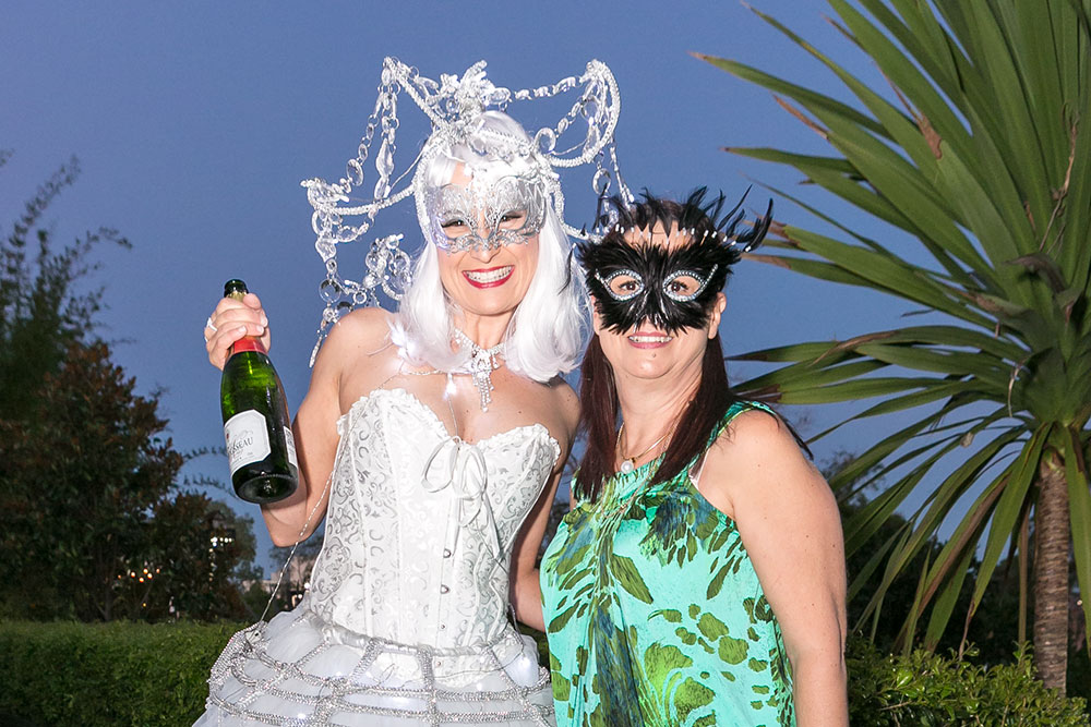 Two ladies at masquerade ball event