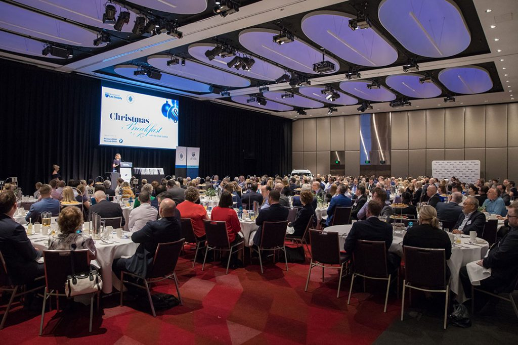 Hilton Brisbane function room with people sitting down