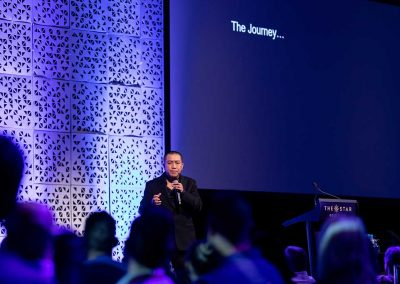 Anh Do presenting at conference at Star Gold Coast