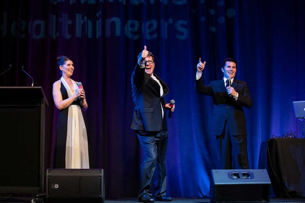 3 opera singers on stage at awards dinner